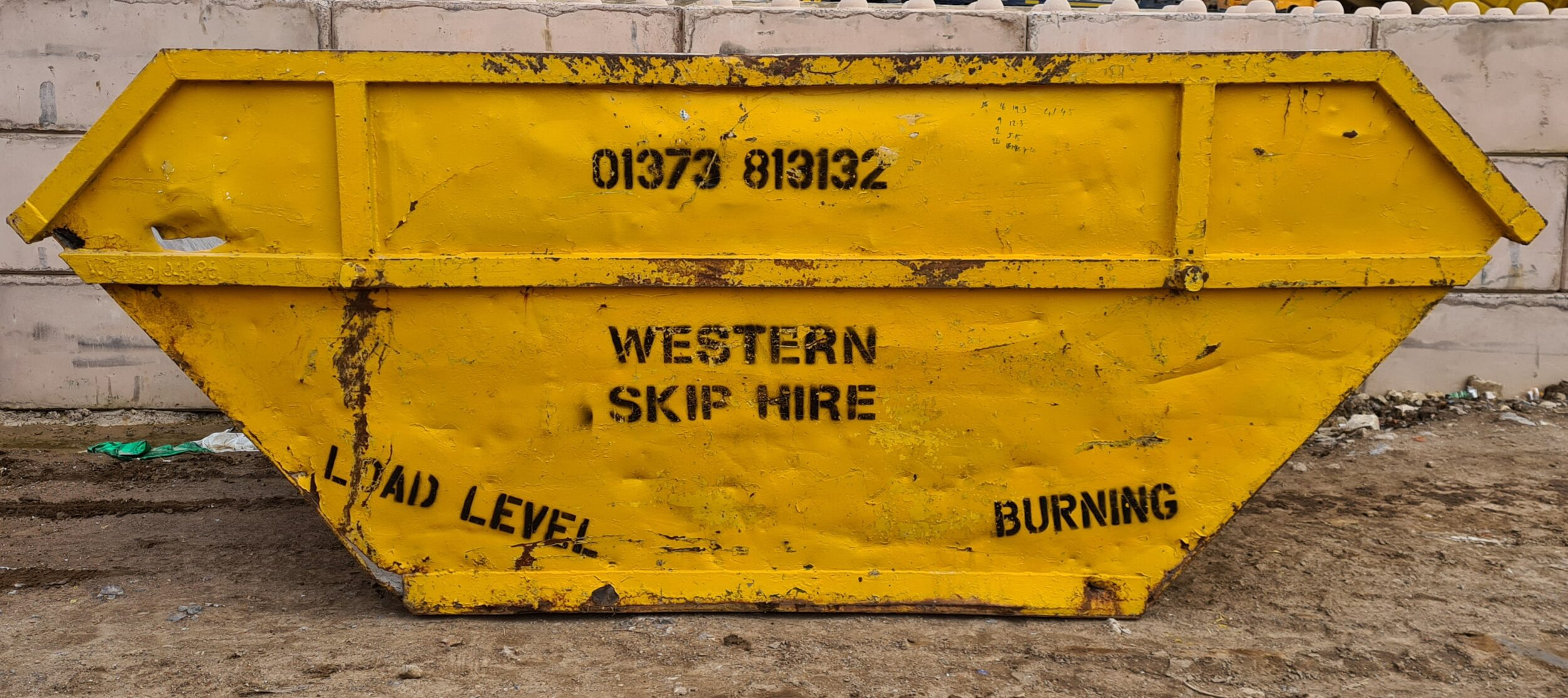 Yellow 10 yard skip. Western Skip Hire, Skip Hire, Sweeper Hire, Aggregates, Recycled Waste Stone and Concrete. Westbury, Frome, Somerset, Wiltshire.