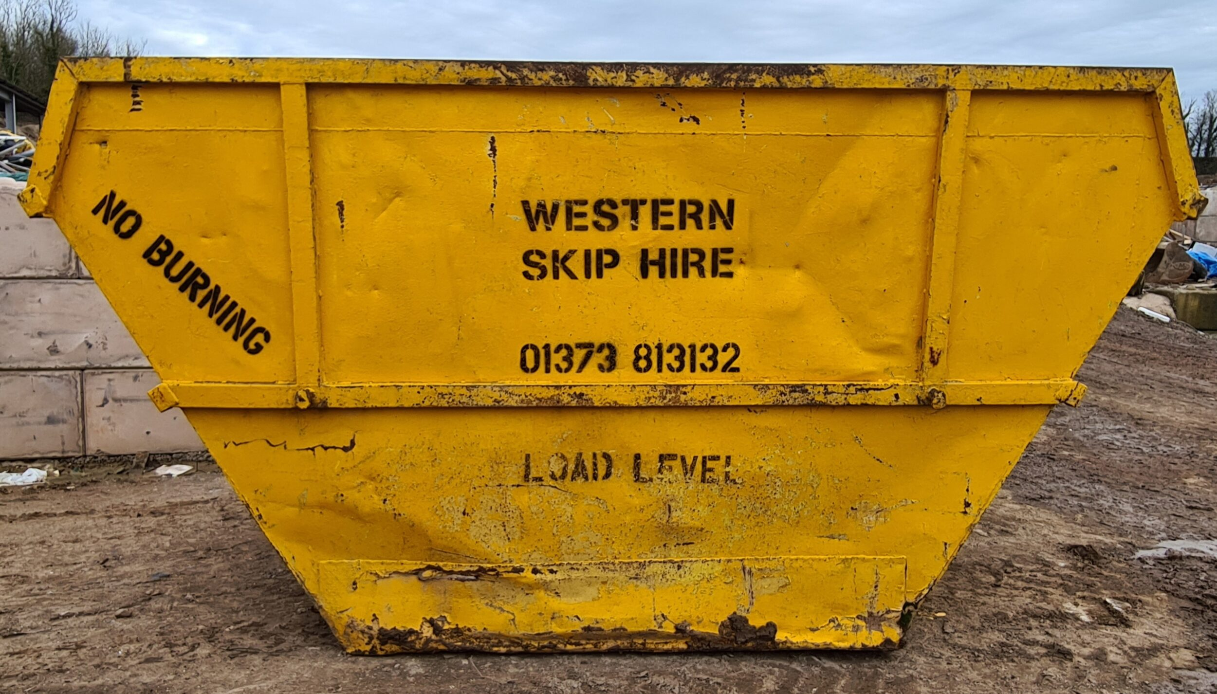 Yellow 14 yard skip. Western Skip Hire, Skip Hire, Sweeper Hire, Aggregates, Recycled Waste Stone and Concrete. Westbury, Frome, Somerset, Wiltshire.