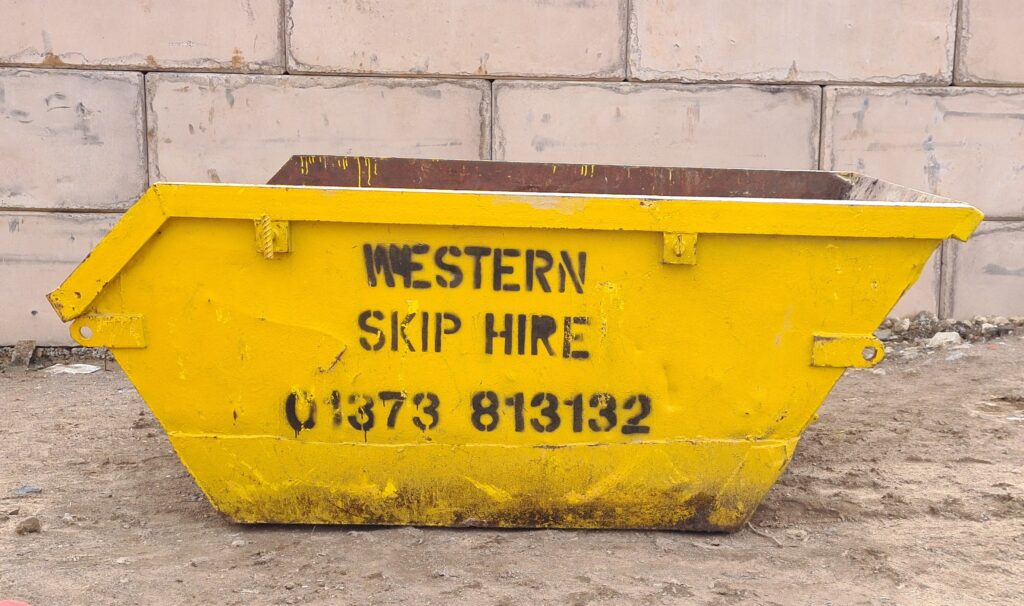 Yellow 3 yard skip. Western Skip Hire, Skip Hire, Sweeper Hire, Aggregates, Recycled Waste Stone and Concrete. Westbury, Frome, Somerset, Wiltshire.