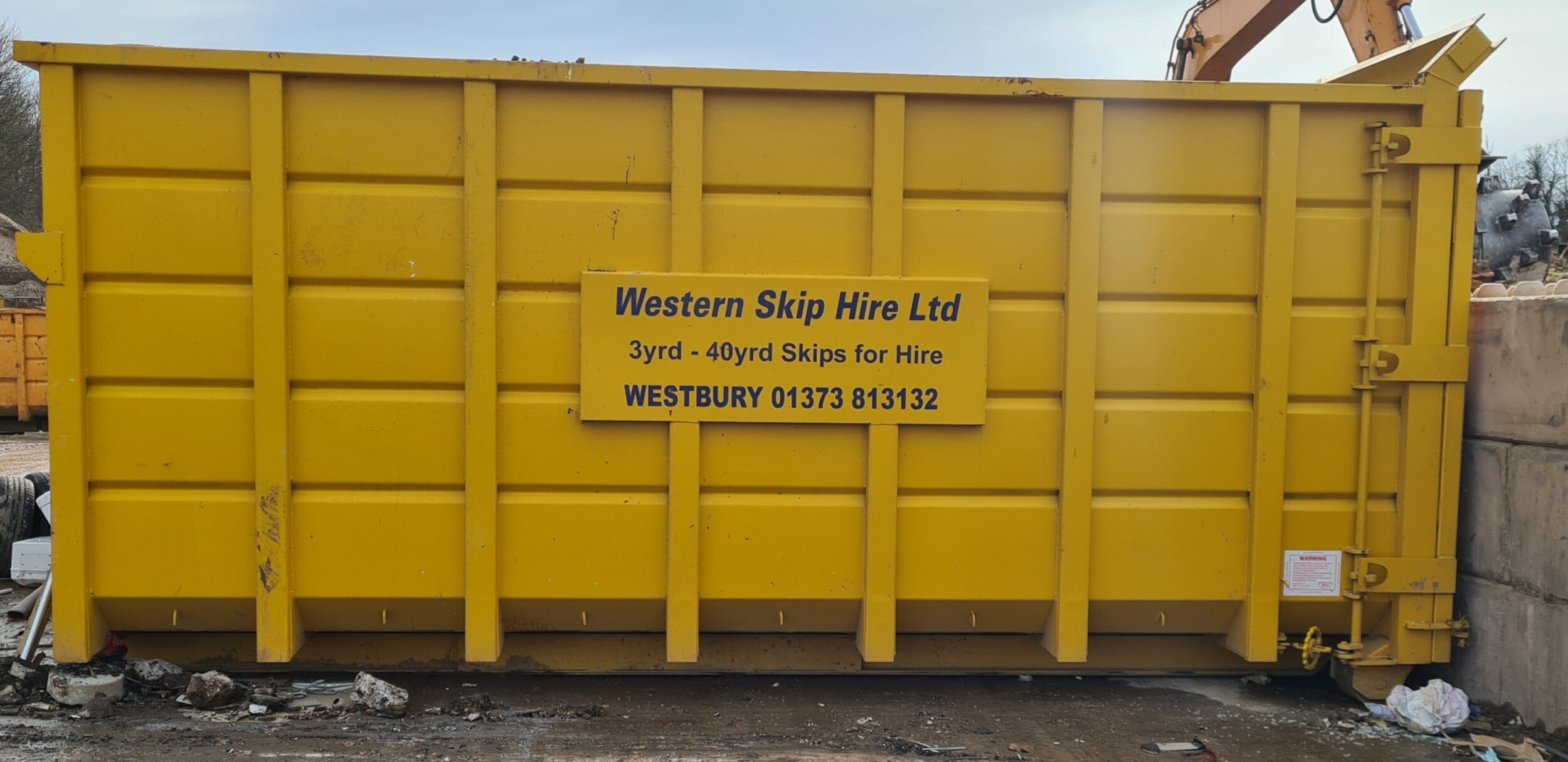 Yellow 40 yard skip. Western Skip Hire, Skip Hire, Sweeper Hire, Aggregates, Recycled Waste Stone and Concrete. Westbury, Frome, Somerset, Wiltshire.
